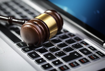 Justice gavel and laptop computer keyboard