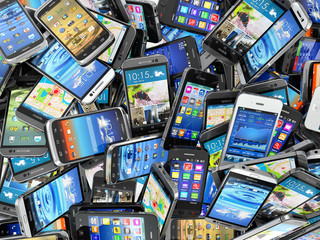 Mobile phones background. Pile of different modern smartphones. Wall mural