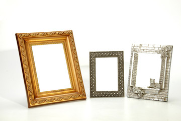 Three Isolated Ornate Empty Picture Frames on White