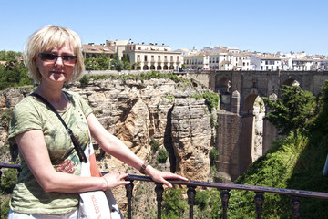 tourist on a background rocks in Ronda, Spain