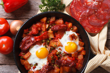 Baked eggs with chorizo and vegetables