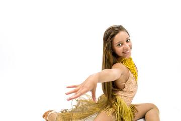 Teenger smiling in golden dress posing for dancing
