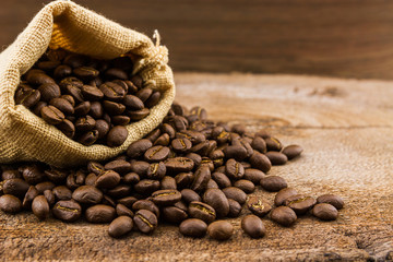 Wall Murals Coffee beans Brown roasted coffee beans in canvas sack.