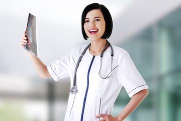 Female doctor analysing x-ray