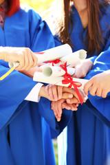 Graduate students with diplomas, close-up