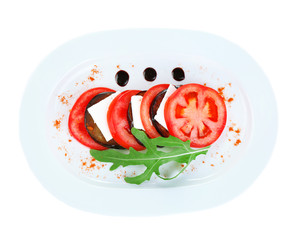 Eggplant salad with tomato and feta cheese, isolated on white