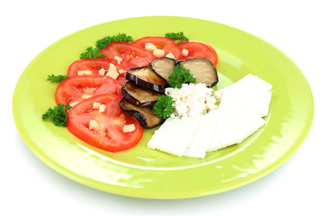Eggplant salad with tomatoes and feta cheese, isolated on white