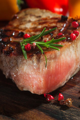 Succulent grilled fillet steak on an wooden board