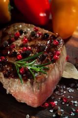 Succulent grilled fillet steak on an wooden board