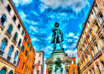 Sculpture of a famous man at Venice Italy. HDR processed