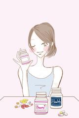 サプリメント錠剤と女性