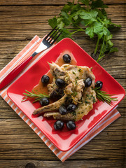 roasted rabbit with herbs and black olives