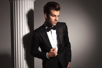 young elegant business man fixing his jacket