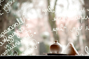 cafe window with writings on glass