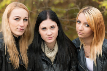 Outdoor portrait of three friends