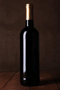 Bottle of red wine on dark background