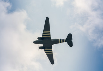 Military airplane as seen from the ground against blue sky