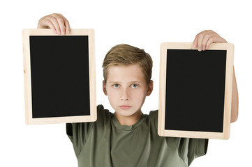 Boy between two black boards middle