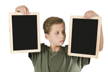 Boy between two black boards right