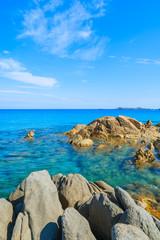 Rocks and azure sea water of Porto Giunco beach, Sardinia island