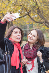 Friends taking picture with smartphone