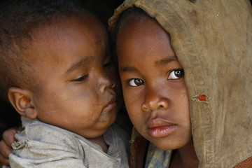 Madagascar-shy and poor african girl with child Wall mural