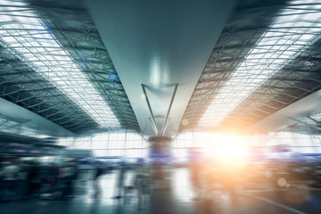 modern international airport terminal lit by sun light