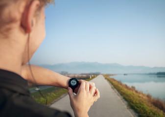 Runner starts his modern stopwatch before jogging
