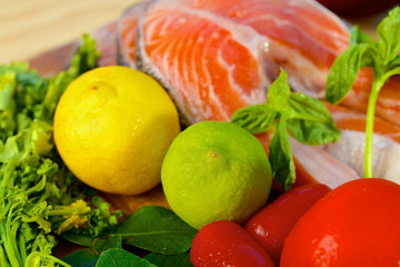 Delicious  portion of fresh salmon fillet with lemon and lime
