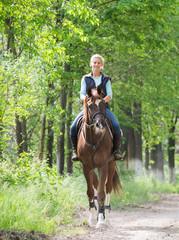 Girl on horseback riding