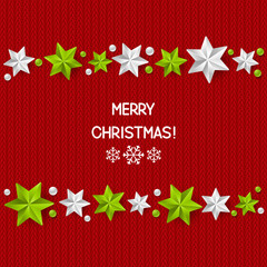 Xmas starry decorations on red knitted background