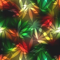 Cannabis leafs on blur rastafarian background.