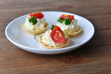 tartlet with cream, tomato and dill