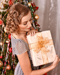 Woman receiving gifts.