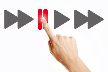Male hand pressing pause button on the virtual screen