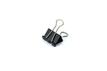 black paper clip on white background