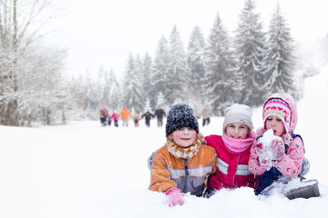 Happy family winter fun outdoors. Active parents with kids runni