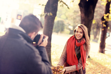 Beautiful woman posing to the camera in the park