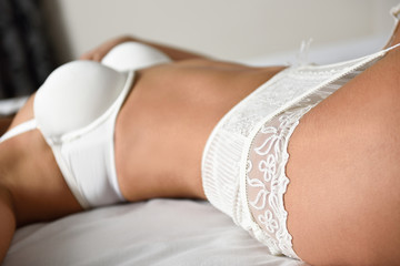 Sexy young woman wearing bride lingerie