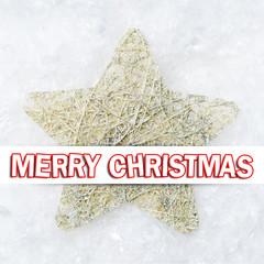 Stern im Schnee mit Merry Christmas Textbotschaft