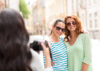 smiling teenage girls with camera