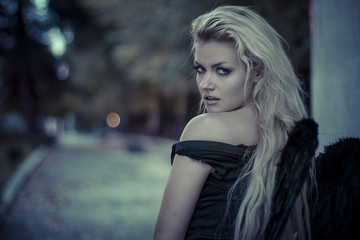 purity, romantic scene, beautiful blond, fallen angel with black