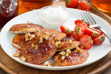 Breakfast with pancakes, fresh strawberries and cream, close-up