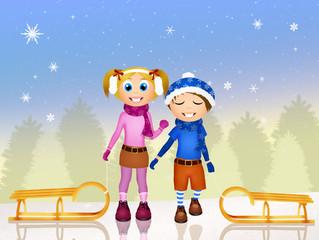 children on sleigh in winter