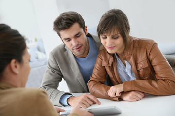 Young couple meeting real estate agent
