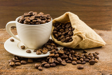 Brown roasted coffee beans in cup.