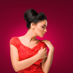 Beauty fashion brunette woman in red dress