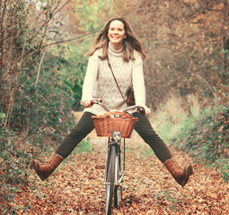 Beautiful woman enjoying nature driving bicycle