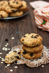 oatmeal cookies with raisins on a dark wooden table