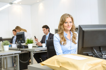 Woman at her office desk